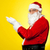 side profile of santa facing camera with open palms stock photo © stockyimages