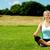 jovem · caucasiano · mulher · ioga · as · pernas · cruzadas · meditando - foto stock © stockyimages