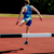 athlete jumping over the hurdle stock photo © stockyimages