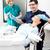 fiatal · nő · orális · kezelés · modern · fogászati · klinika - stock fotó © stockyimages