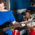 człowiek · patrząc · kobieta · gry · gitara · muzyki - zdjęcia stock © stockyimages