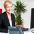 smiling corporate woman typing on keyboard stock photo © stockyimages