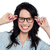Joyous woman holding her spectacles stock photo © stockyimages
