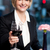 happy businesswoman holding wine glass stock photo © stockyimages