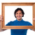smiling guy looking through picture frame stock photo © stockyimages