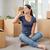 счастливым · брюнетка · женщину · сидят · полу · говорить - Сток-фото © stokkete