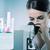 jonge · vrouw · wetenschapper · werken · microscoop · laboratorium · lab - stockfoto © stokkete
