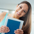 smiling student holding books stock photo © stokkete