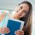 glimlachend · vrouwelijke · student · boeken · portret - stockfoto © stokkete
