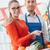 vrouw · supermarkt · winkel · assistent · plantaardige · plank - stockfoto © stokkete