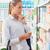 vrouw · supermarkt · winkelen · lijst · jonge · vrouw - stockfoto © stokkete