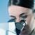 vrouwelijke · onderzoeker · microscoop · jonge · laboratorium - stockfoto © stokkete