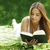 young woman reading book stock photo © stokkete