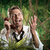 furious businessman on the phone lost in the jungle stock photo © stokkete
