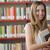 студент · портрет · молодые · улыбаясь · библиотека · образование - Сток-фото © stokkete