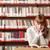молодые · студент · библиотека · портрет · серьезный · чтение - Сток-фото © stokkete