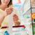 élelmiszer · nyugta · felismerhetetlen · nő · világoskék · póló - stock fotó © stokkete