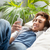 guy with headphones on sofa stock photo © stokkete