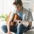 lied · jonge · man · spelen · gitaar · vergadering · sofa - stockfoto © stokkete