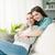 sofá · sorridente · sala · de · estar · mulheres - foto stock © stokkete