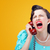 angry woman screaming on the phone stock photo © stokkete