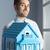 agent · immobilier · modèle · maison · accueillant · bleu · clair · sourire - photo stock © stokkete