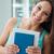 smiling student holding books stock photo © stokkete