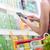 женщину · смартфон · супермаркета · продуктовых · торговых - Сток-фото © stokkete