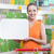 smiling woman holding a white sign at supermarket stock photo © stokkete