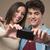 young couple taking selfies stock photo © stokkete
