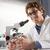 mosolyog · férfi · tudós · laborköpeny · tart · molekuláris - stock fotó © stokkete