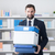 businessman carrying a box and office folders stock photo © stokkete