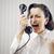 young woman shouting into telephone stock photo © stokkete
