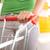 vrouw · supermarkt · groene · tshirt · voortvarend · winkelwagen - stockfoto © stokkete