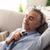 zakenman · sofa · home · ontspannen · handen - stockfoto © stokkete