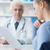 orvos · olvas · orvosi · lemezek · vonzó · nő · beteg - stock fotó © stokkete