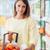 nő · áruház · mosolyog · fiatal · nő · vásárlás · tart - stock fotó © stokkete