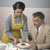 vintage woman serving lunch to her husband stock photo © stokkete
