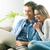 couple relaxing on sofa with laptop stock photo © stokkete