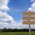 jelzőtábla · zöld · fű · mező · kék · ég · felhők · tavasz - stock fotó © stoonn