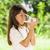 bambina · bere · latte · bottiglia · poco · profondo · campo - foto d'archivio © stoonn
