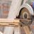 carpenter using circular saw in loggers stock photo © stoonn
