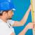 carpenter or builder measuring a plank of wood stock photo © stryjek