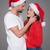 loving young couple in red santa hats stock photo © stryjek