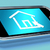 House Symbol On Mobile Screen Shows Real Estate Or Rentals stock photo © stuartmiles