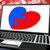 puzzle heart on laptop shows engagement stock photo © stuartmiles