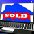 Sold On House On Laptop Shows Sold Property stock photo © stuartmiles