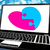 puzzle heart on laptop showing online dating stock photo © stuartmiles