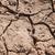 secas · solo · rachado · terra · fundo · deserto - foto stock © supertrooper