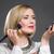 beautiful middle aged woman applying blush stock photo © svetography